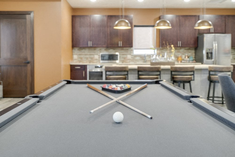Pool table in the new west clubhouse at North Pointe Villas luxury apartments near 14th and Fletcher
