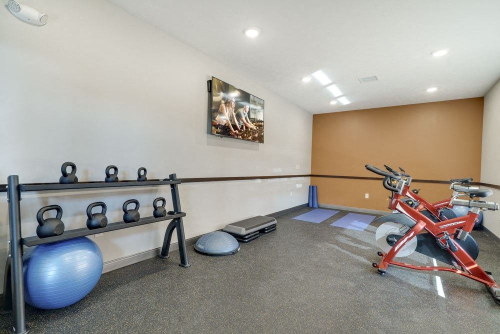 Yoga and spin studio with on-demand fitness classes at North Pointe Villas luxury apartments in north lincoln NE