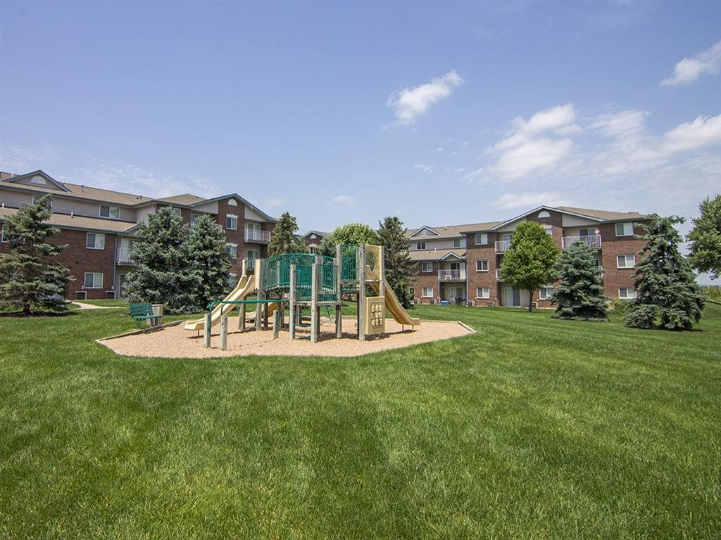Northridge Heights Apartments Playground with Building View in Lincoln NE