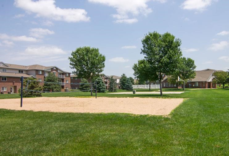 Northridge Heights Apartments Vollyball Court with Building View in Lincoln NE