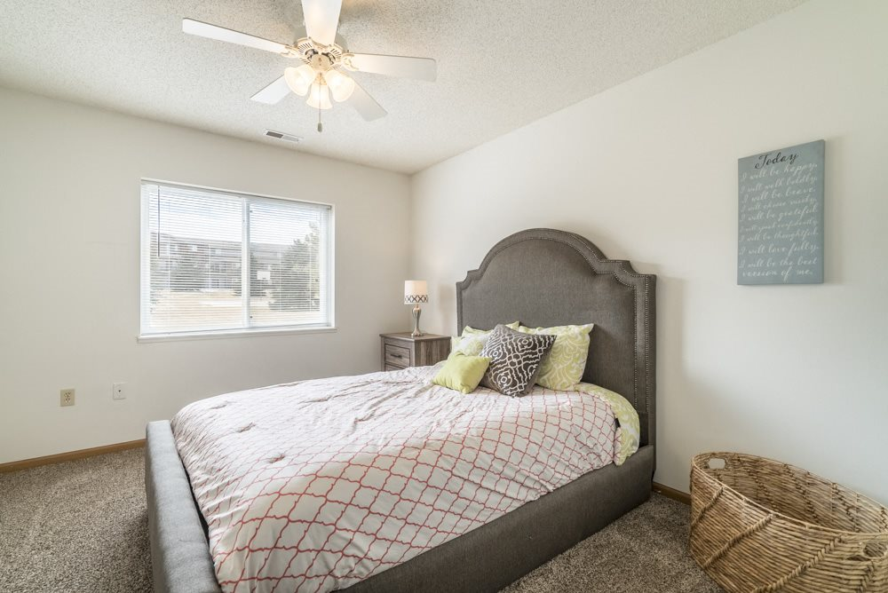 Interiors-2-bedroom master bedroom with ceiling fan at Northridge Heights in Lincoln NE