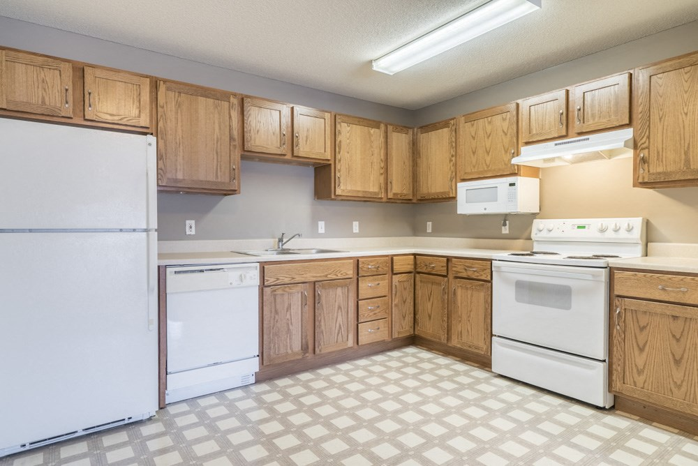 Interiors-Kitchen with white appliances and tons of cabinetry at Northridge Heights in north Lincoln