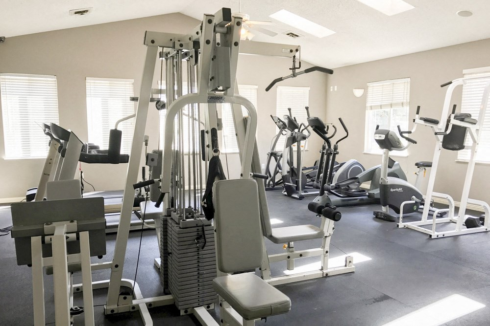 Interiors-Fitness center with cardio and strength equipment at Northridge apartments in Lincoln, NE