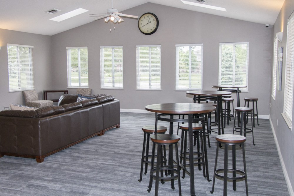 Exteriors-Newly renovated clubhouse includes TV lounge and tables for residents