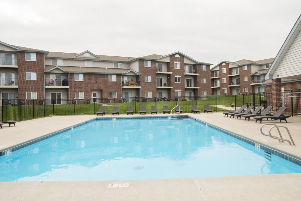 Exteriors-Swimming pool with view of greenspace and community buildings at Northridge in LIncoln