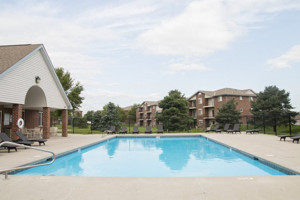 Exteriors-Swimming pool with view of buildings in the background at Northridge in Lincoln, NE