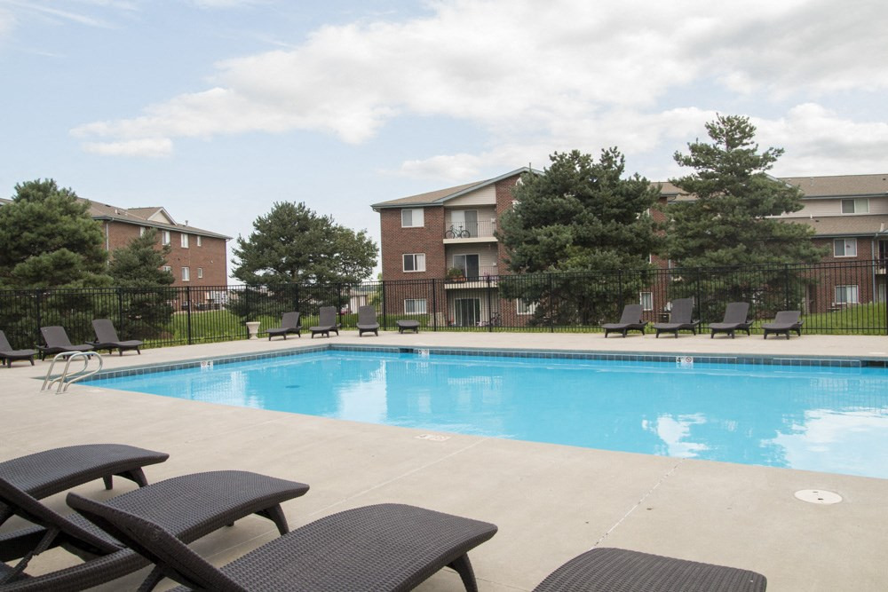 Exteriors-Swimming pool with lounge chairs at Northridge Heights apartments in North Lincoln