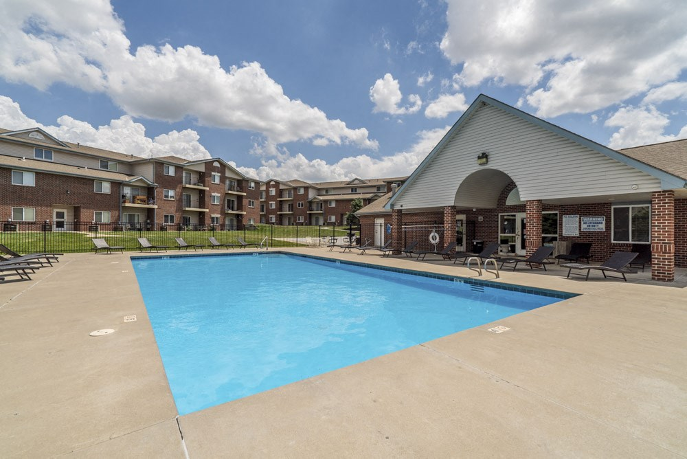 Pool with lounge chairs at Northridge Heights Apartments!