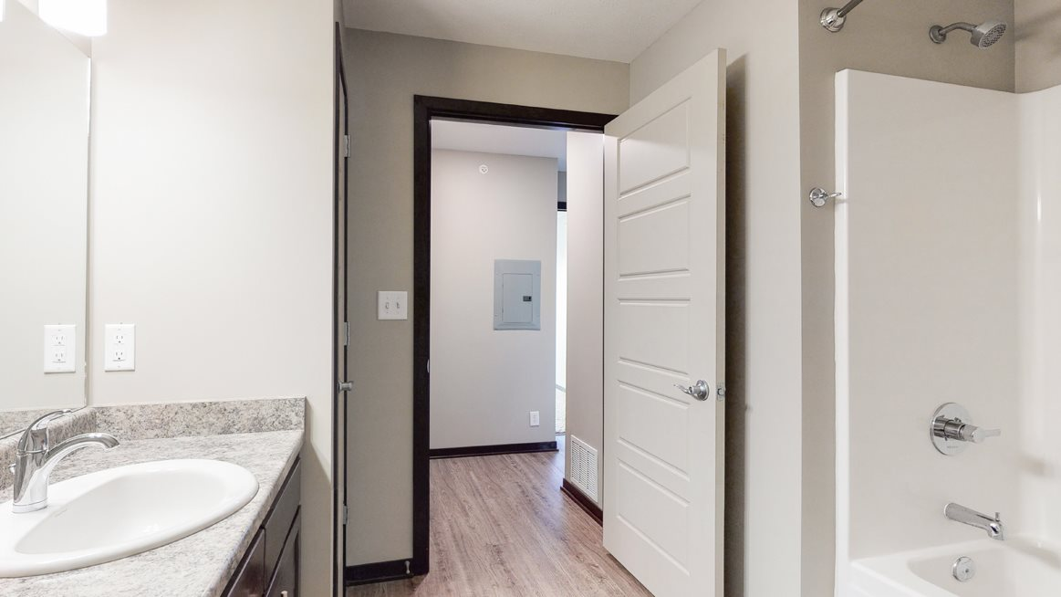 Renovated bathroom with linen storage closet at Northridge Heights Apartments