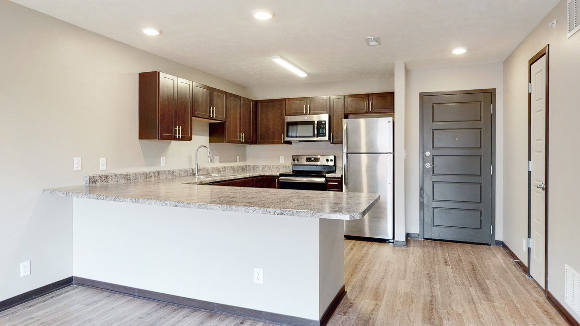 Renovated kitchen with large peninsula island with ample storage at Northridge Heights