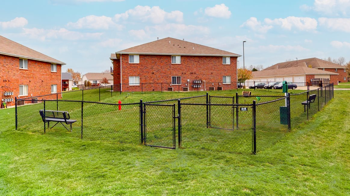 Large fenced dog park with grass at Northridge Heights apartments in Lincoln
