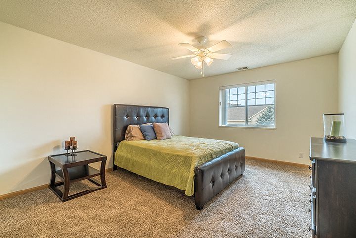 Bedroom with ceiling fan at The Northbrook Apartment Homes, Lincoln, NE