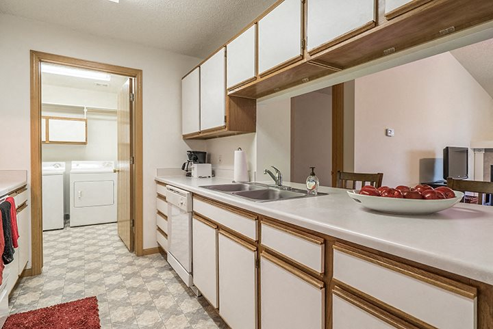 Kitchen with laundry attached at The Northbrook Apartment Homes, Lincoln, NE