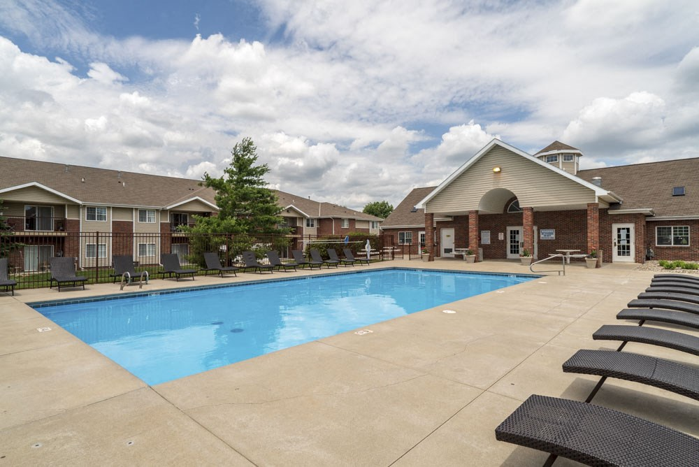 Pool with lounge chairs at Northbrook Apartments!