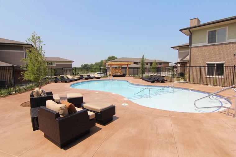 swimming pool and sun deck at Villas at Wilderness Ridge in Lincoln Nebraska