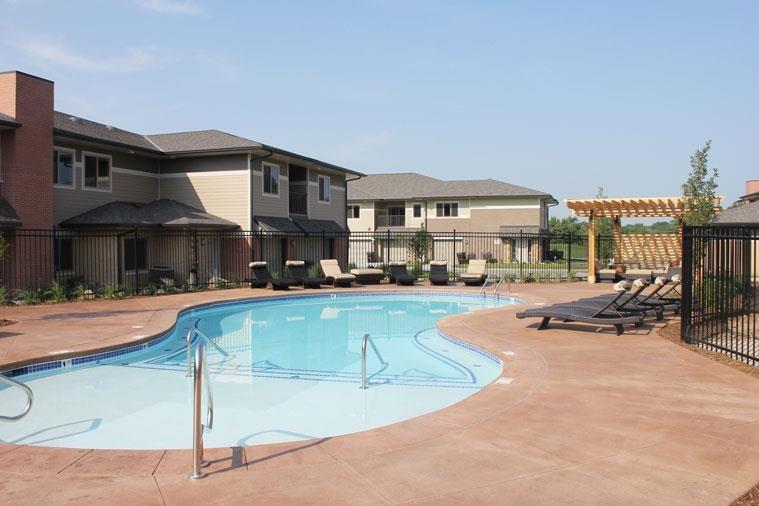 pool with sun deck at Villas at Wilderness Ridge in Lincoln Nebraska