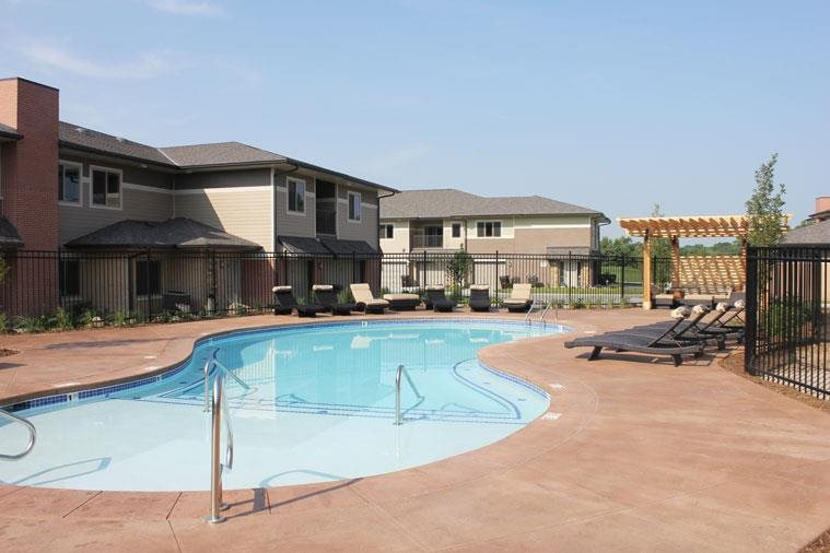 pool with sun deck at Villas at Wilderness Ridge in Lincoln Nebraska