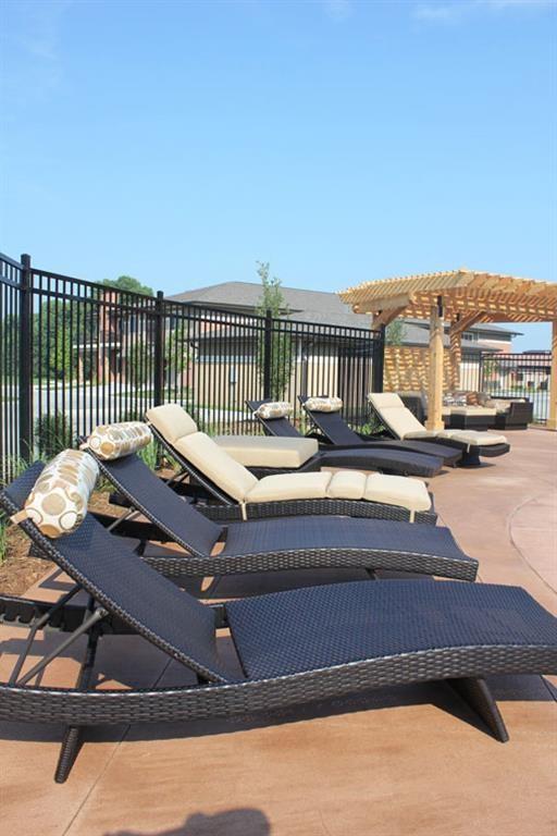 lounging chairs at pool at Villas at Wilderness Ridge in Lincoln Nebraska