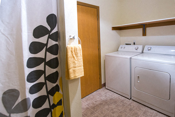 Large main bathroom with washer and dryer