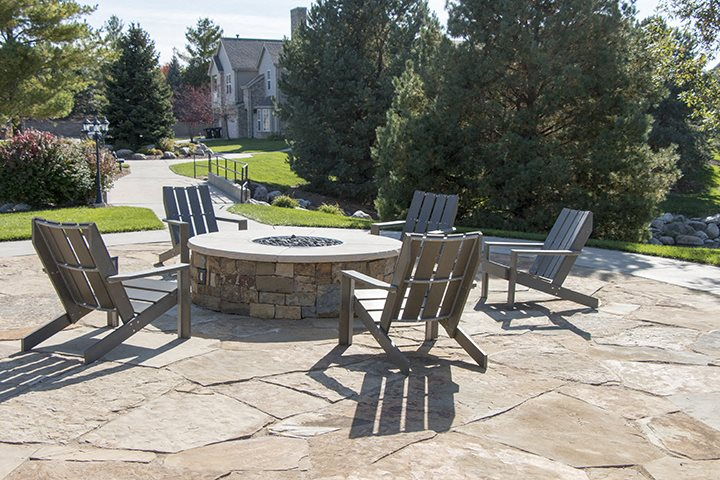 Exteriors-Fire pit next to the private community pond at Stone Ridge townhomes in South Lincoln NE
