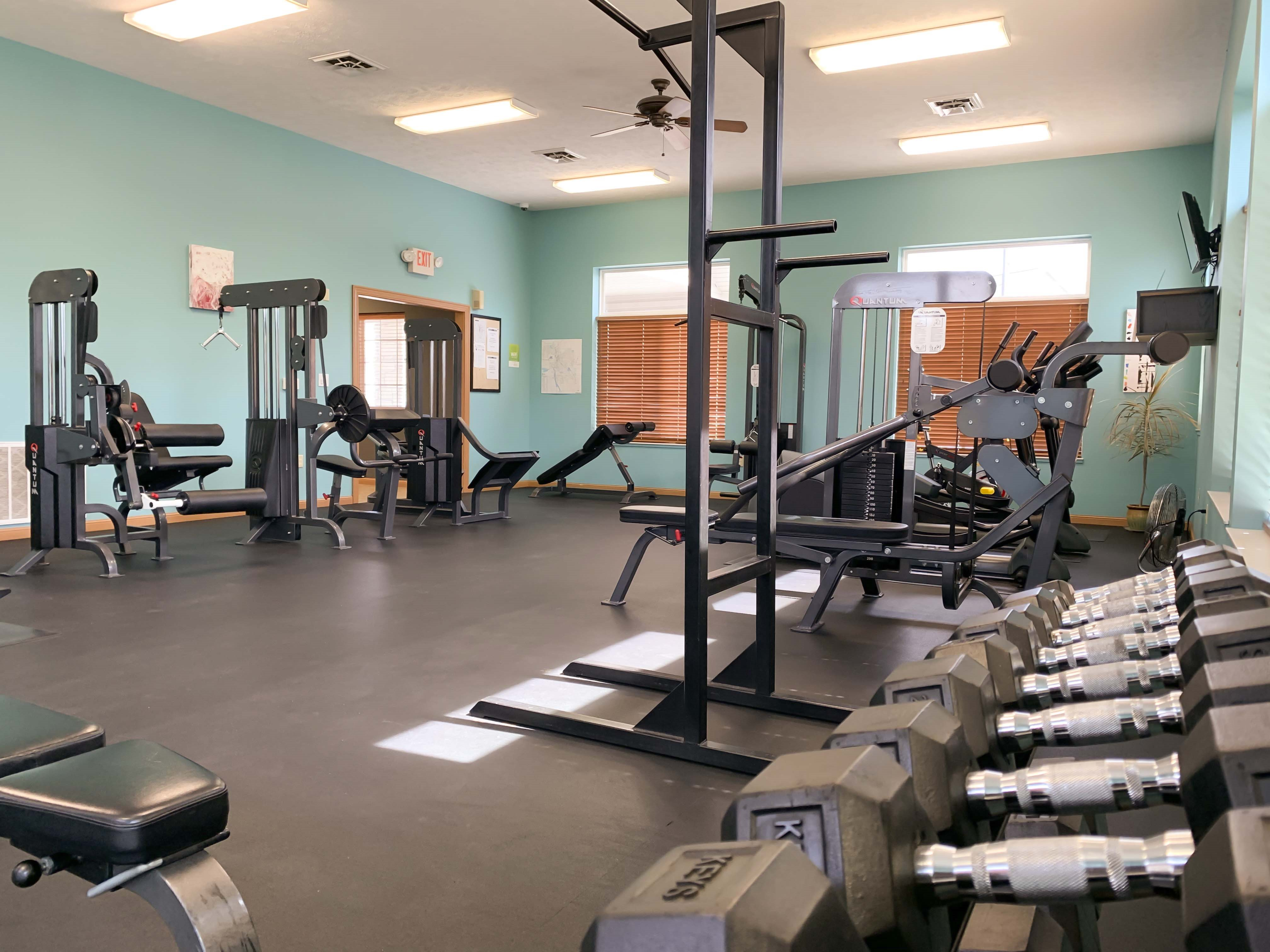 The spacious exercise room at Stone Ridge Estates features a wide variety of machines and free weights