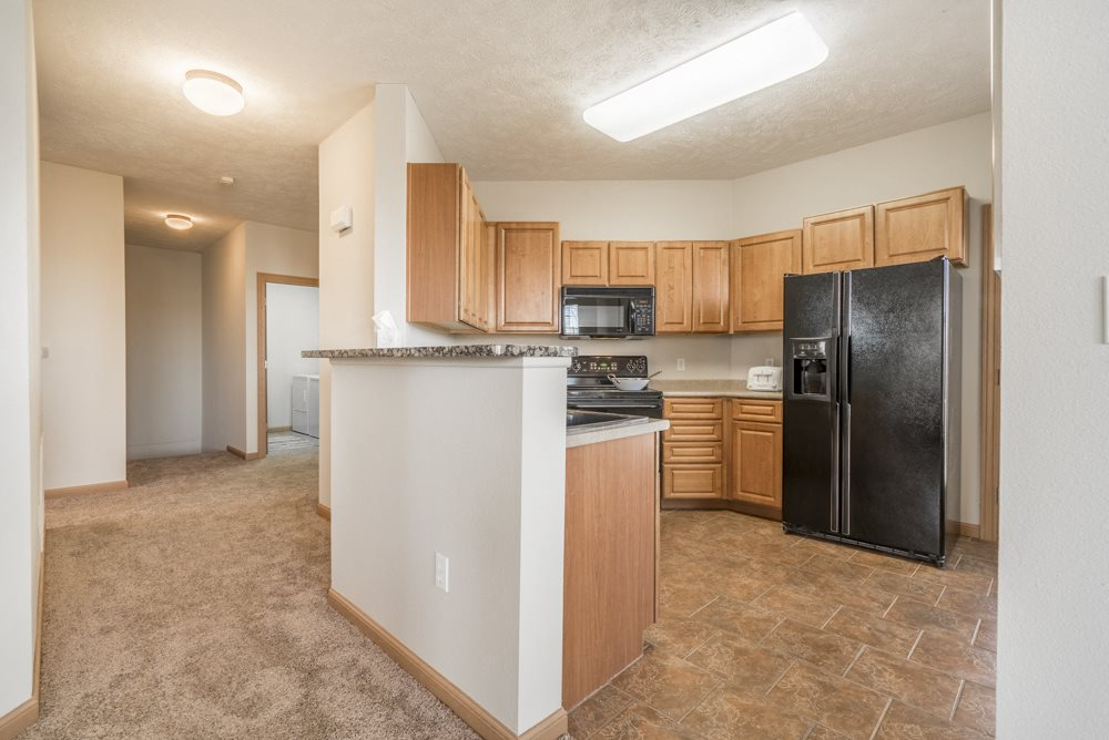 Large kitchen with side-by-side fridge at Stone Ridge Estates townhomes in south Lincoln NE