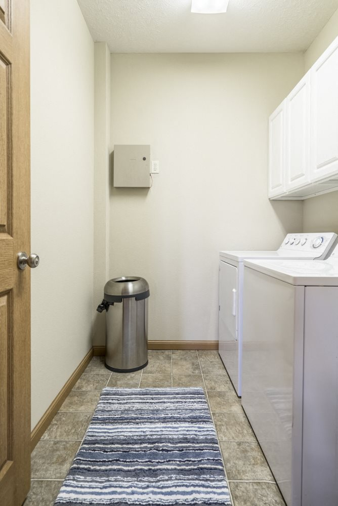 Separate laundry room with full-size washer and dryer included at Stone Ridge townhomes in south Lincoln NE
