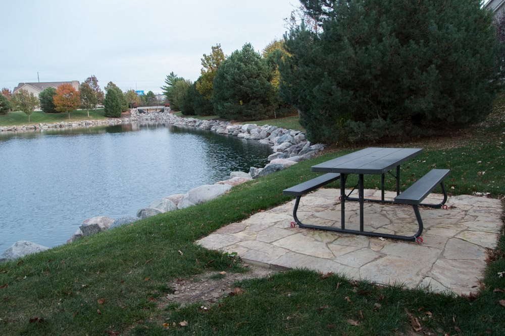 Picnic area overlooking private pond at Stone Ridge Estates in Lincoln NE