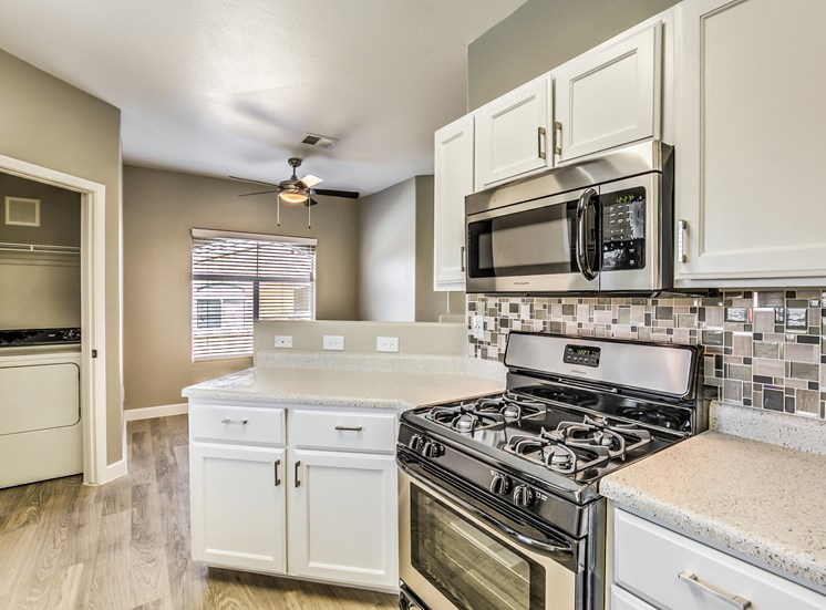 Undermount Kitchen Sinks With Integrated Sprayer at Calypso Apartments, Las Vegas, NV