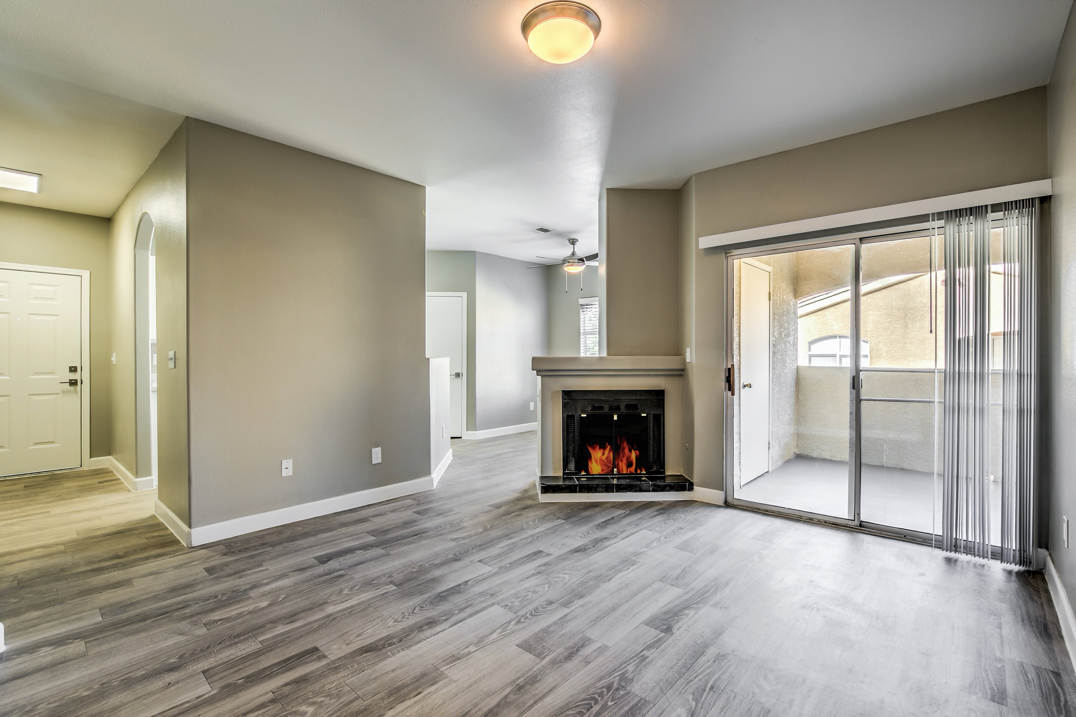 Spacious Living room with Fireplace at Calypso Apartments, Las Vegas, NV