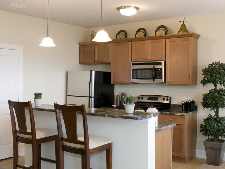 Kitchen with Island at Long Pond Shores Waterfront Apartments, Rochester, NY