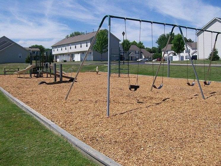 Playground with Swing Set at Stone Hedge Village Townhouses, Farmington, NY