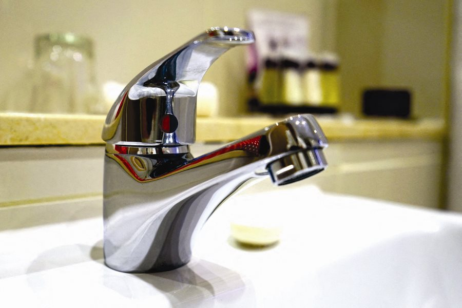 close up of shiny faucet