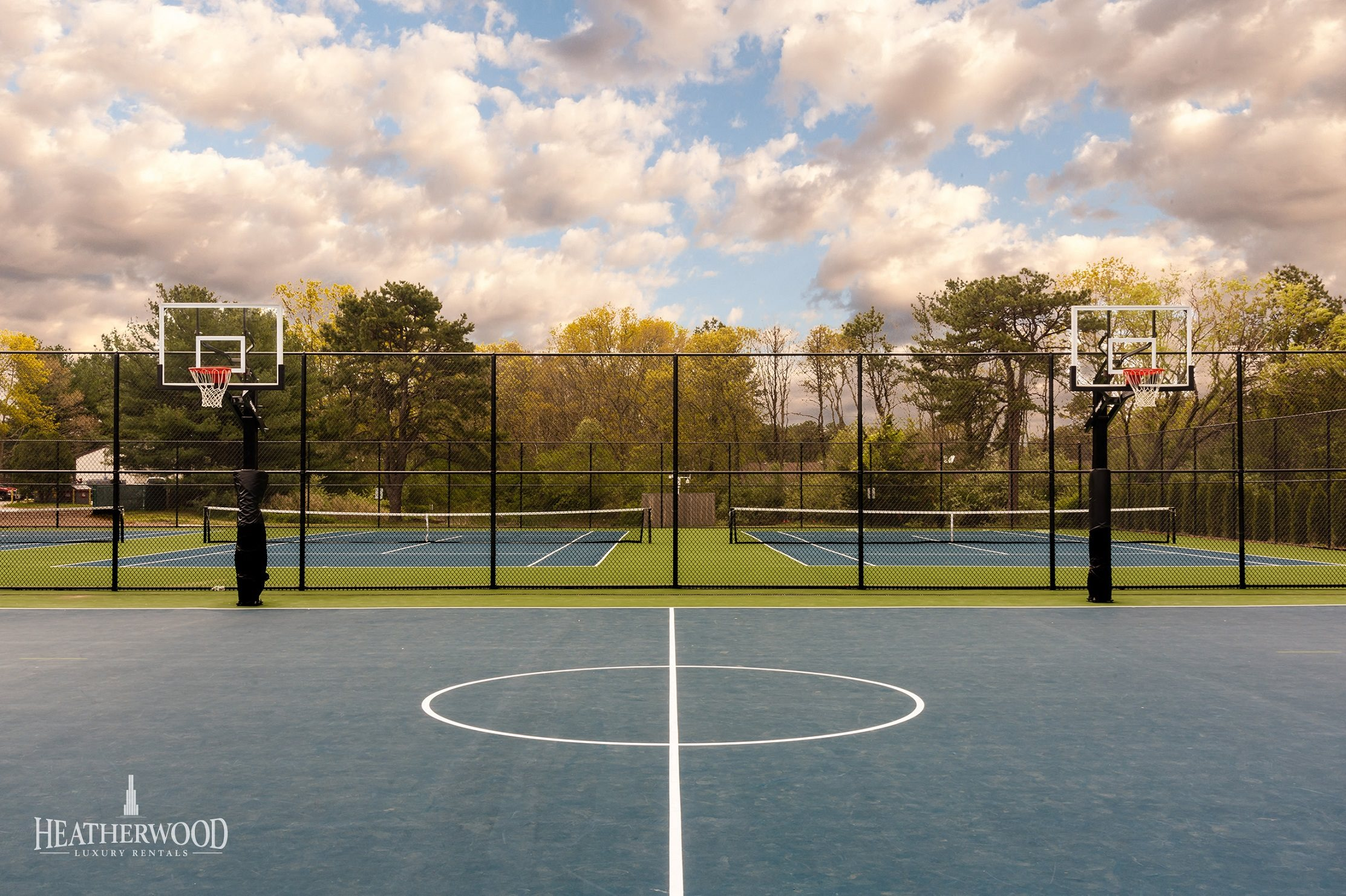 Basketball Court with Tennis Courts in the Background