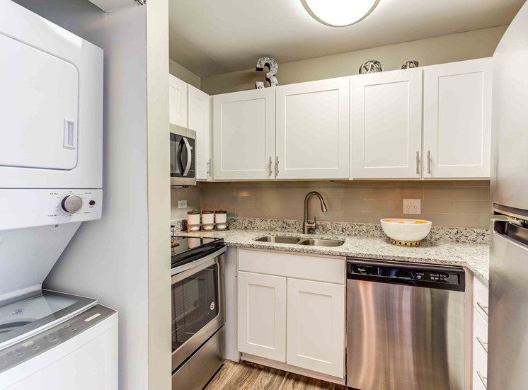 updated kitchen with stainless steel appliances and white cabinets