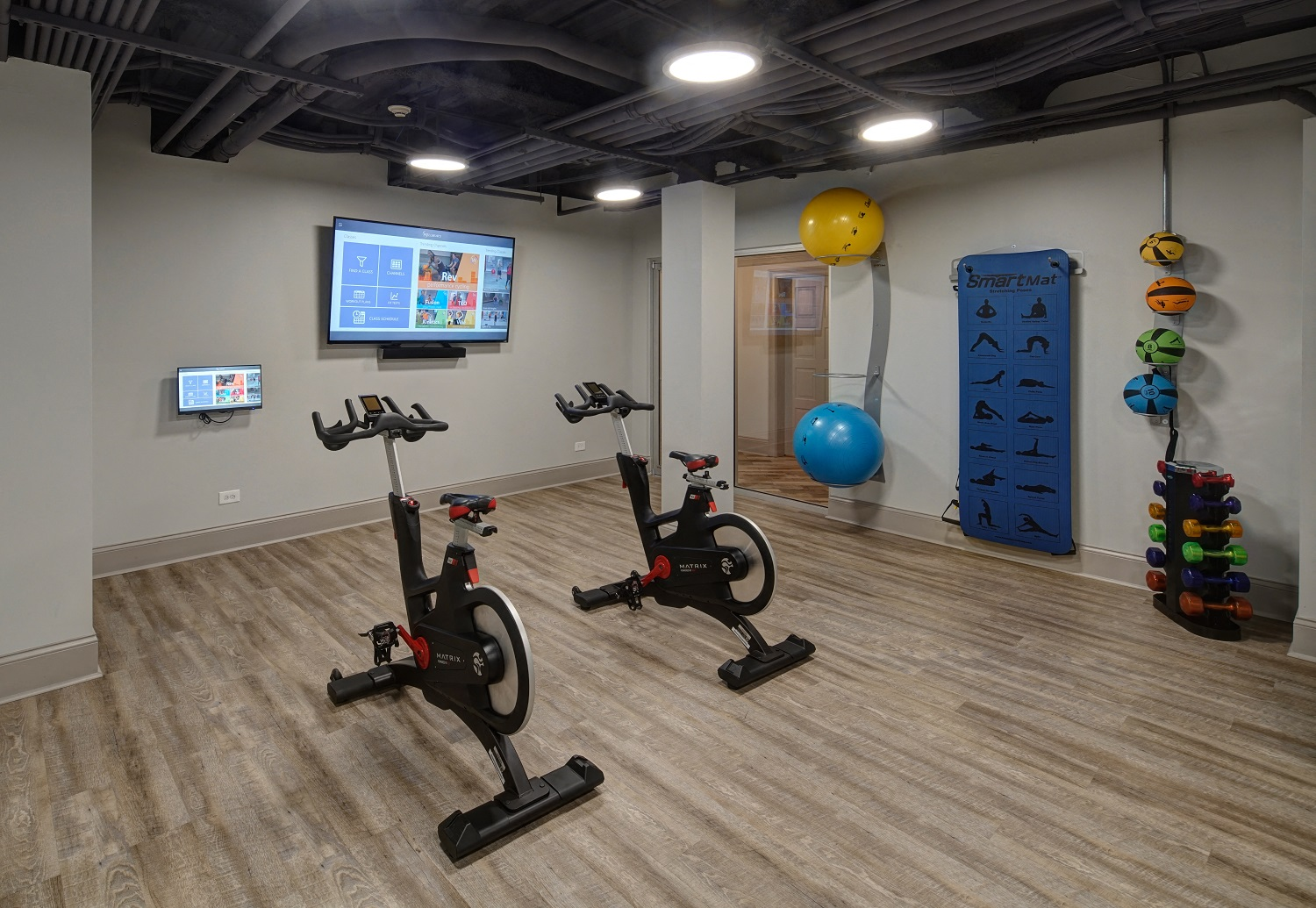 Fitness Center with Separate Spin Room at City View at the Highlands, Lombard, IL