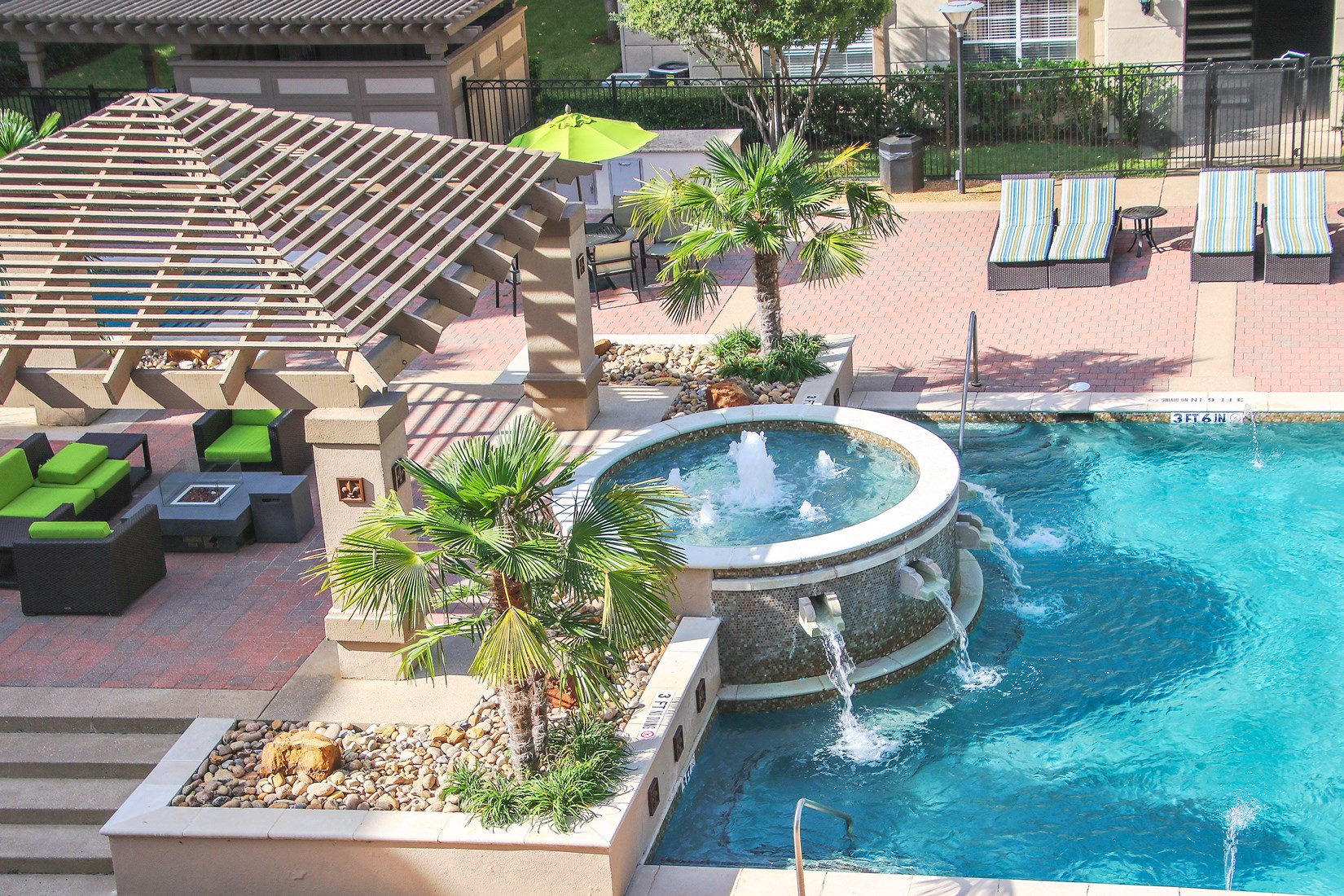 Swimming Pool and Sun Deck at 7900 at Park Central Apartments in Dallas, TX