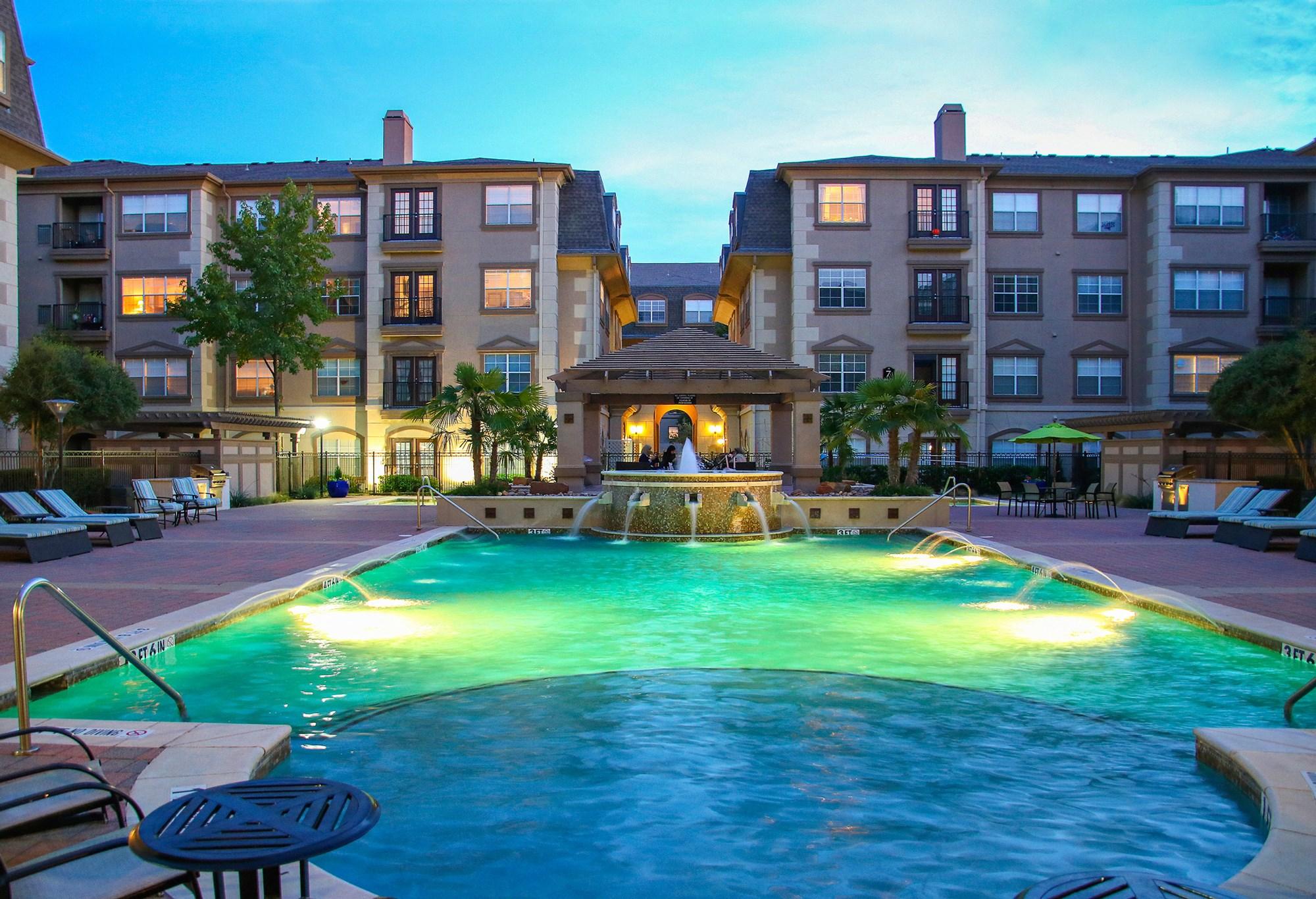 Swimming Pool at Night at 7900 at Park Central Apartments in Dallas, TX
