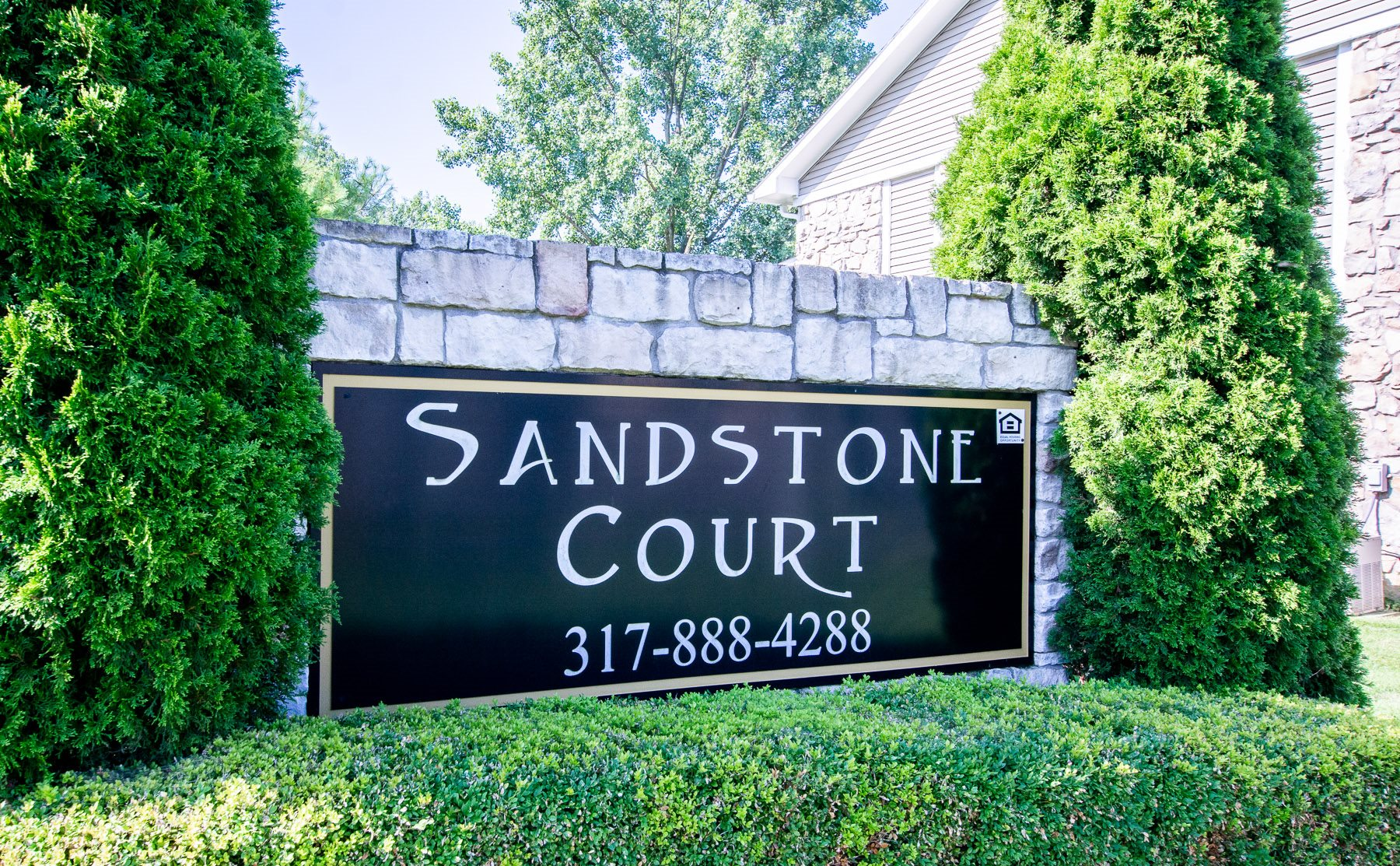 Welcoming Property Sign at Sandstone Court Apartments, Greenwood, IN