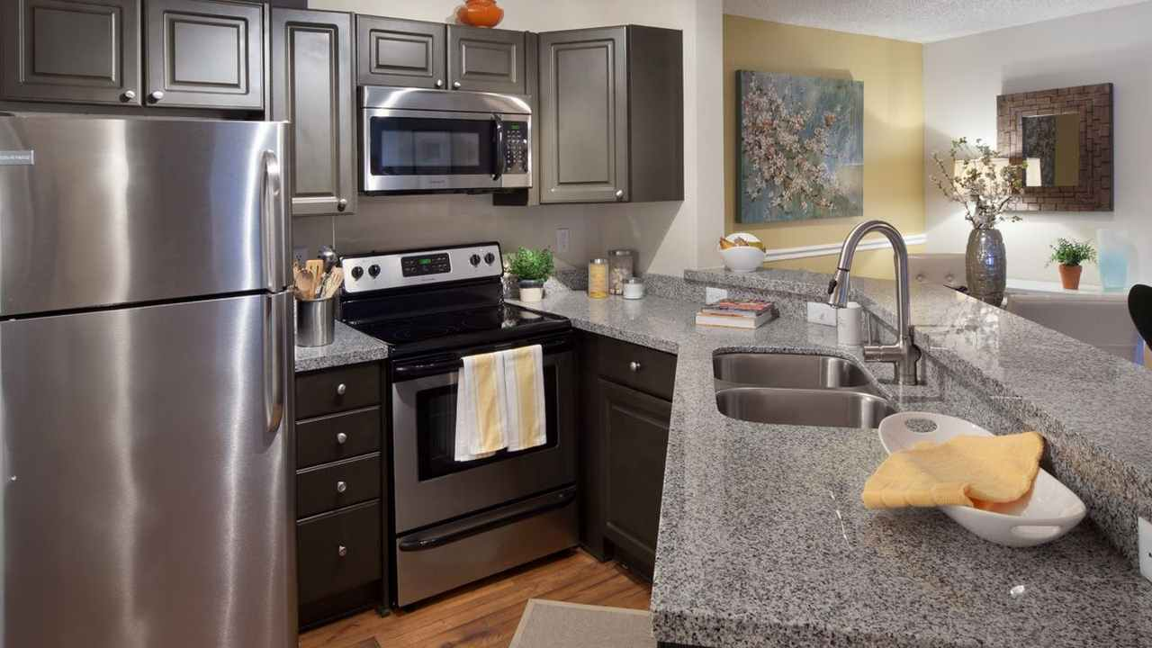 Gourmet Kitchen With Granite Countertops At The District At Clearwater,  Clearwater, FL, 33759