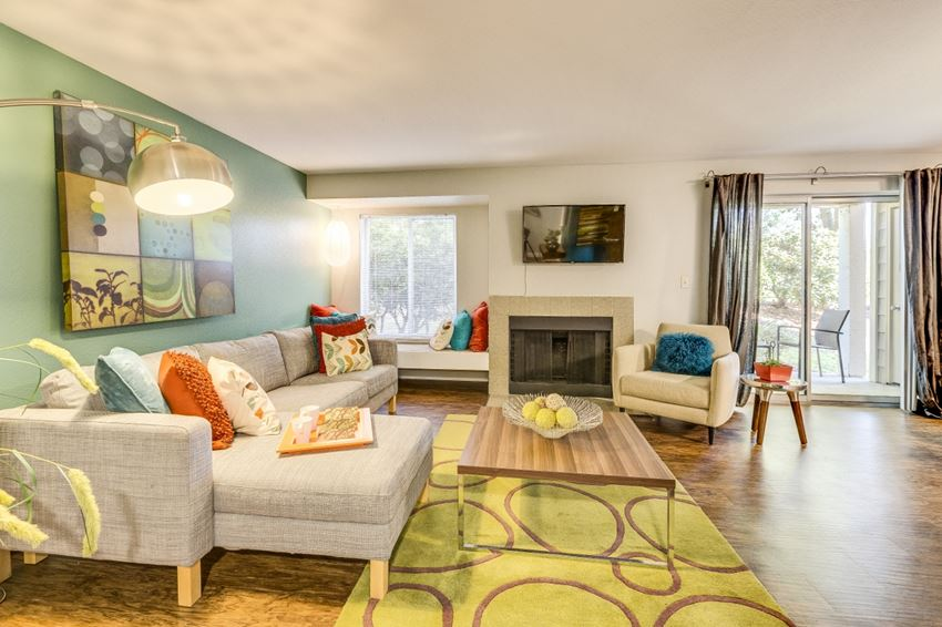 Apartments for Rent Beaverton, OR -MonteVista Spacious Living Room with Wood Style Flooring and Fireplace
