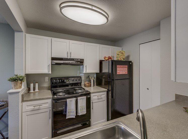 Spacious Kitchen with Pantry Cabinet at Cedar Crest, 4800 SW Mueller Drive, OR