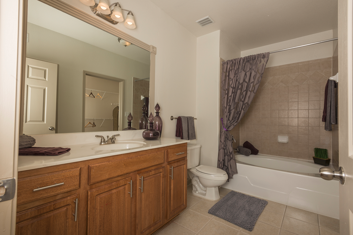 Large Soaking Tub In Master Bathroom with A Tile Surround at Marquette at Piney Point, Texas, 77063