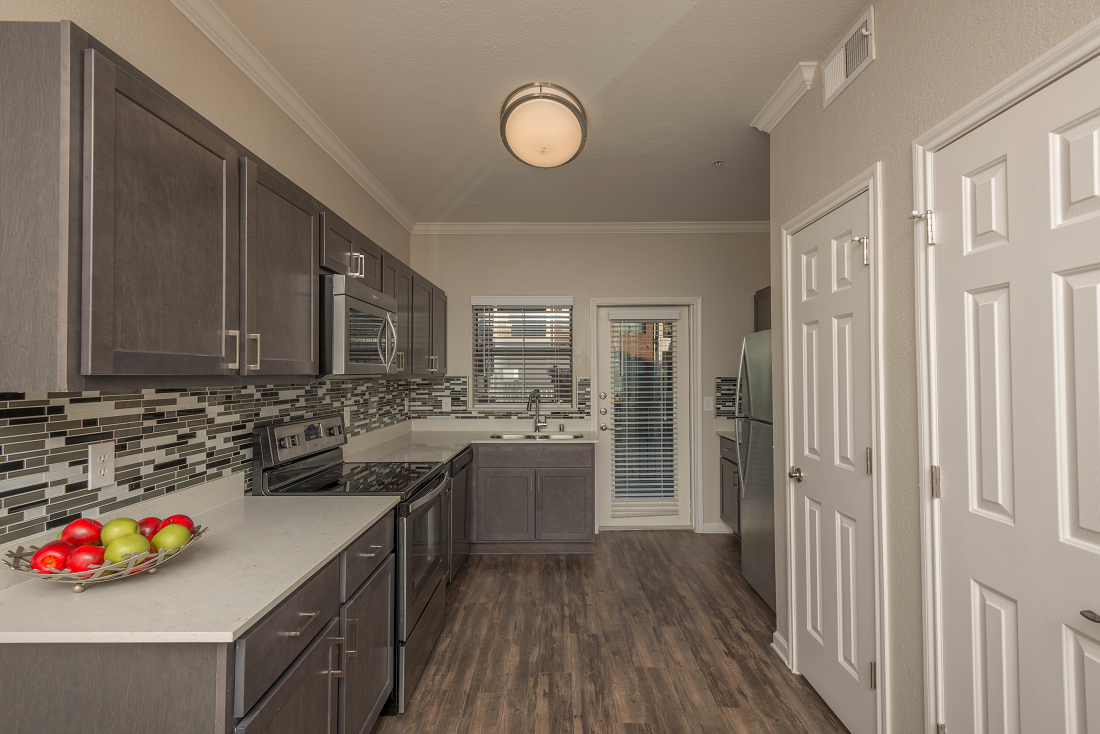 Fully equipped kitchen at Marquette at Preston Park, Plano, TX, 75093