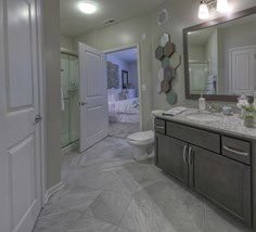 Bathroom with framed mirror and stand up glass shower