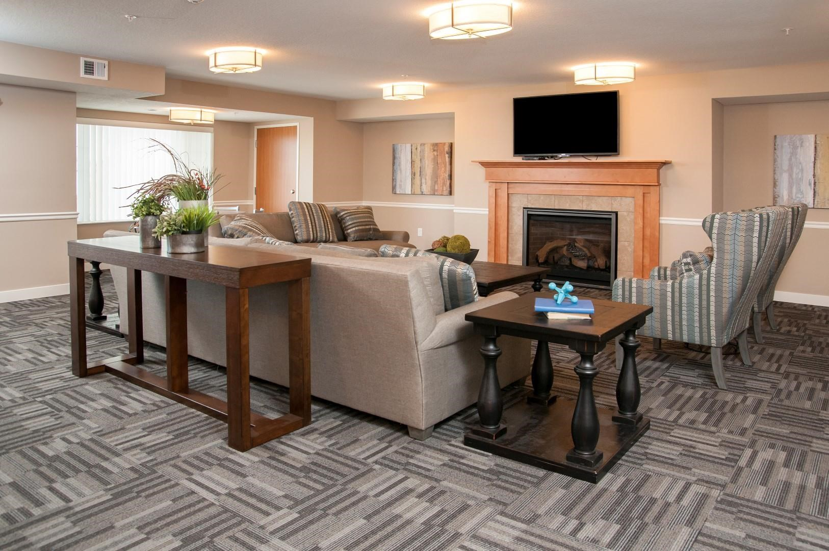Community Room with Flat screen Television, Comfortable seeing area and Fireplace at Carver Crossing