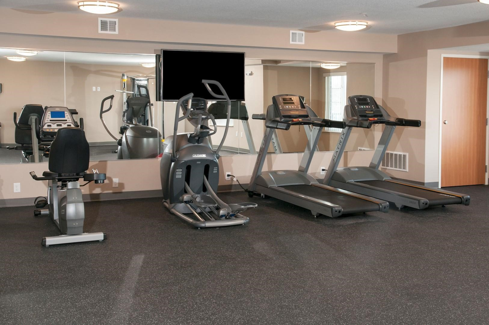 Carver Crossing Fitness Room with Bike, Elliptical and Treadmill Machines