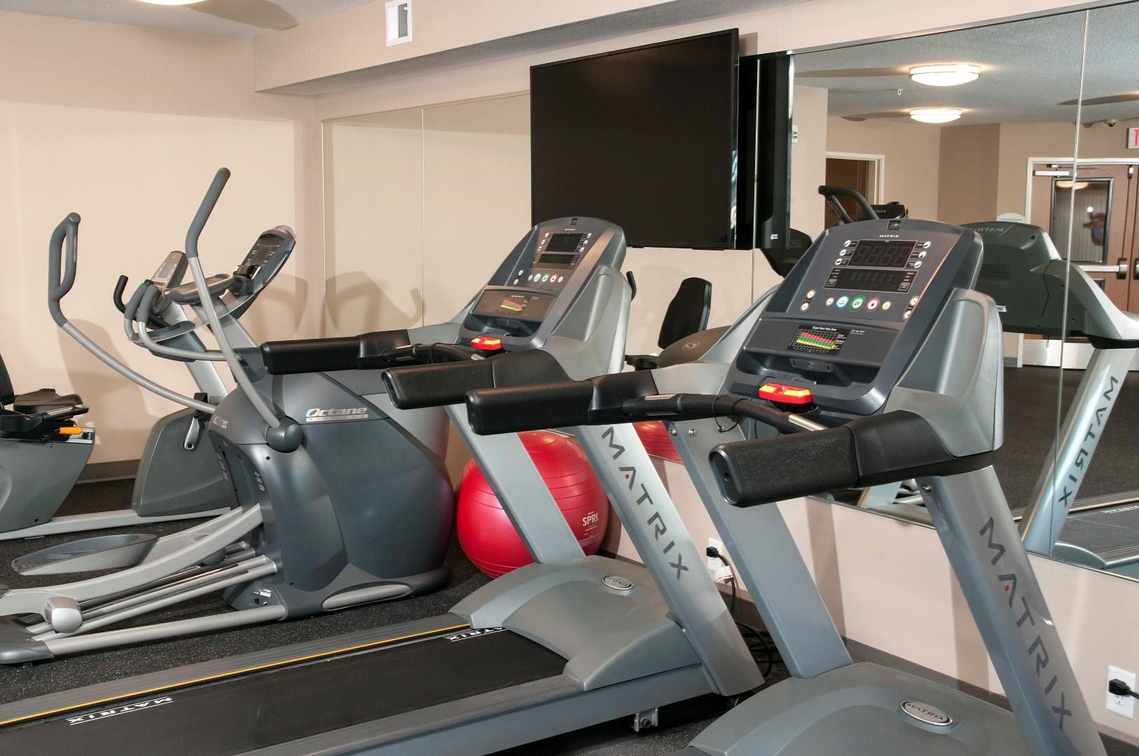Fitness studio in Carver MN Apartment Building with Cardio Equipment