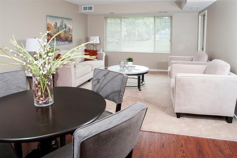 Dinging Room with Dark Wood-like Vinyl Flooring at Apartment in Carver Minnesota