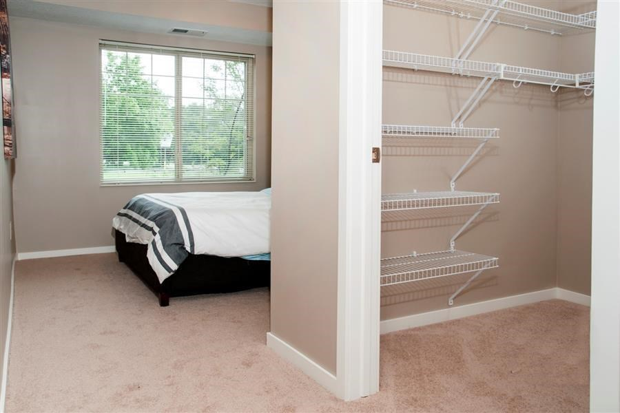 Walk-in Closet Connected to Master Bedroom with Built in Storage Racks at Carver Crossing